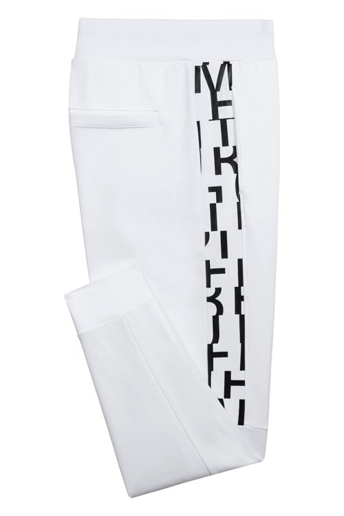 Hugo Boss - Regular-fit cuffed trousers in cotton with printed inserts - 4
