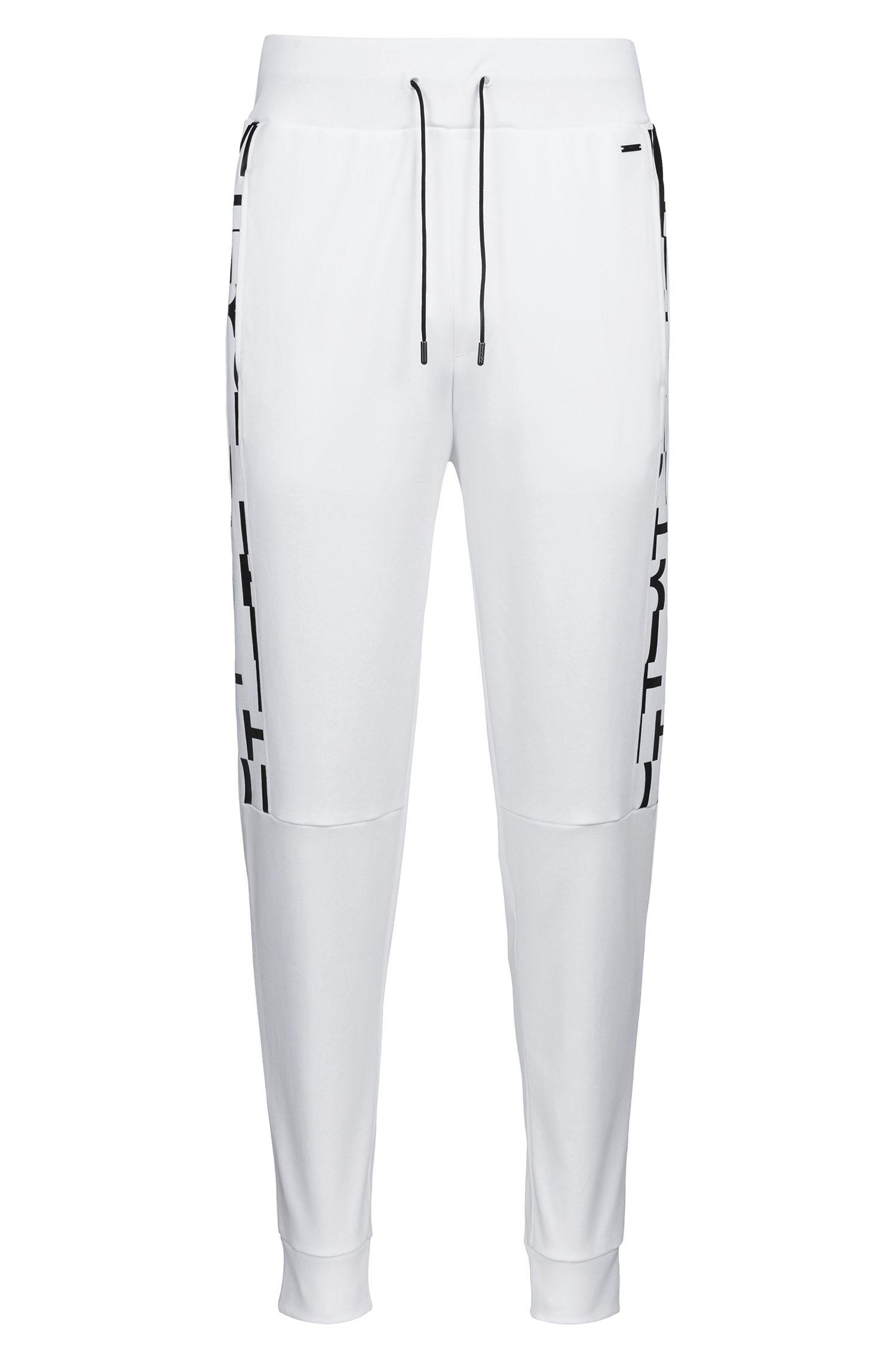 Hugo Boss - Pantalon Regular Fit en coton resserré au bas des jambes, avec empiècements imprimés - 1