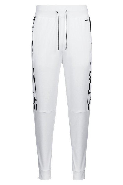 Hugo Boss - Regular-fit cuffed trousers in cotton with printed inserts - 1