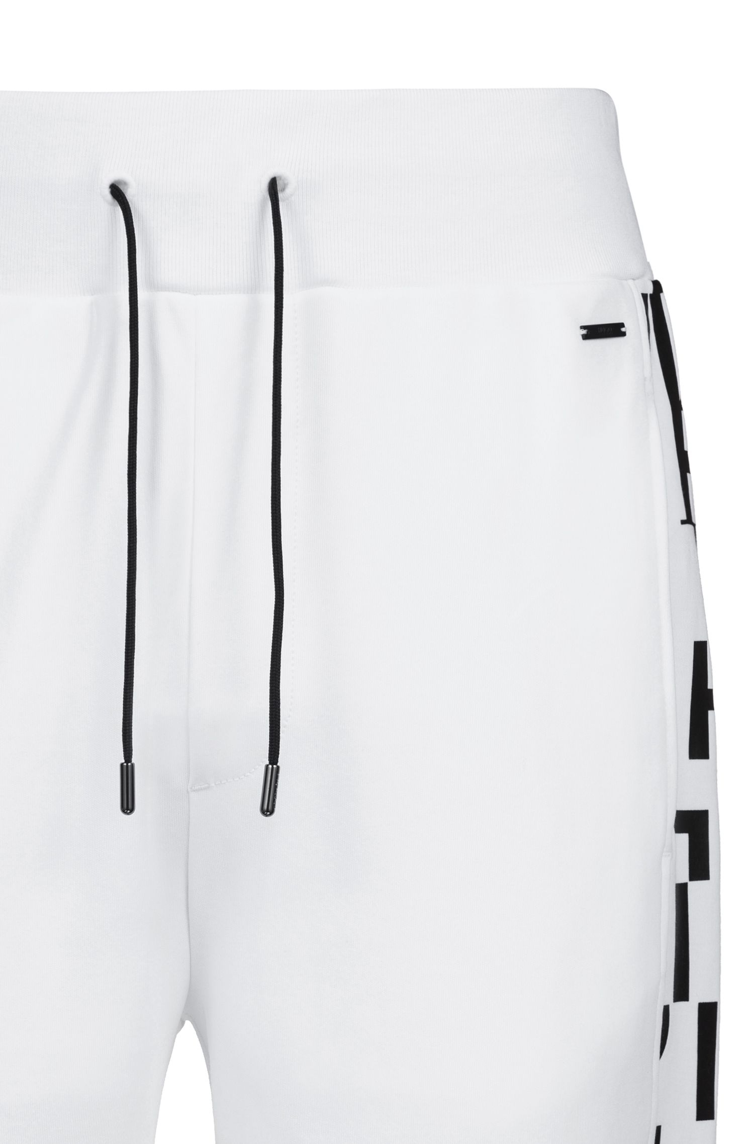 Regular-fit cuffed trousers in cotton with printed inserts, White