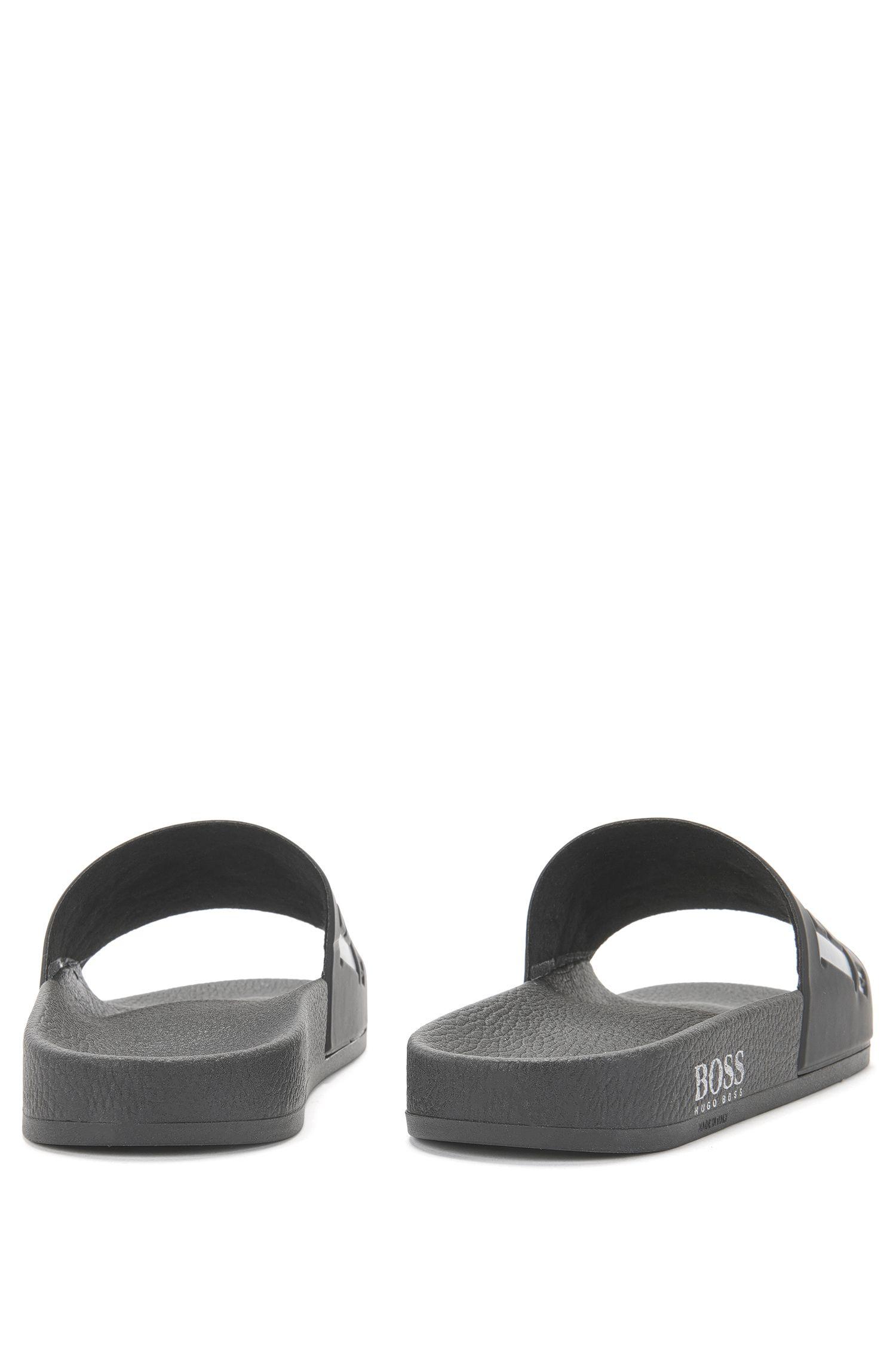 In Italien gefertigte Slides aus Gummi mit kontrastfarbenem Logo, Schwarz