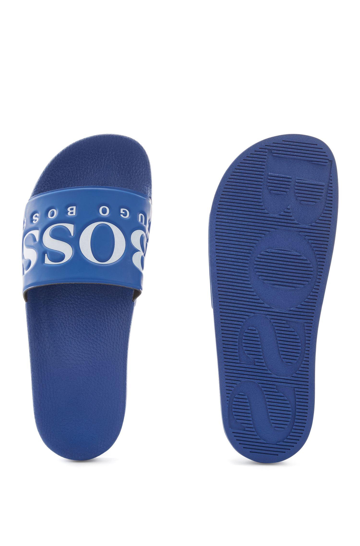 Sandali bassi in gomma realizzati in Italia con logo a contrasto, Blu