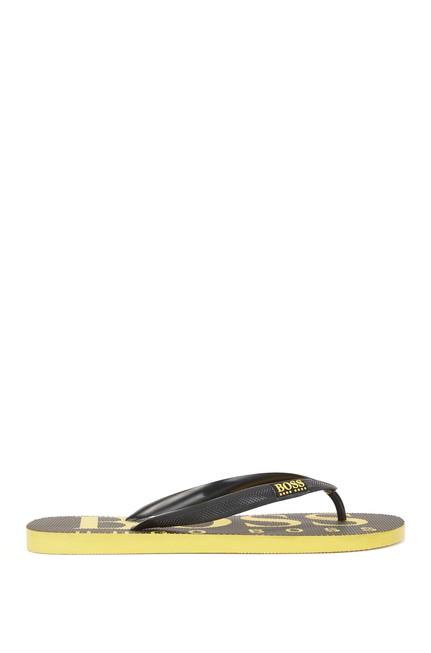 Flipflops aus Gummi mit kontrastfarbenem Logo, Schwarz