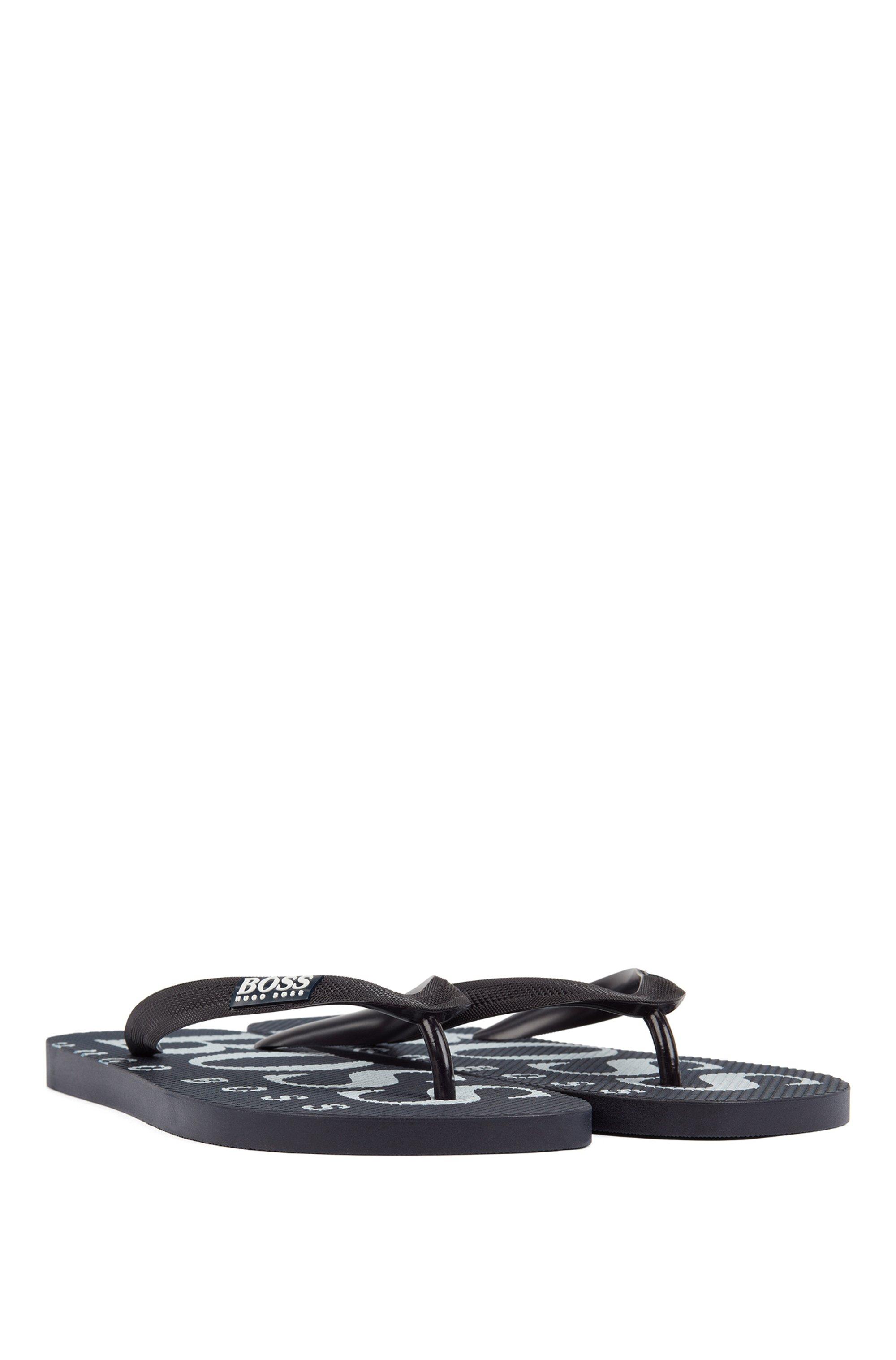 Teenslippers van rubber met contrasterend logodetail