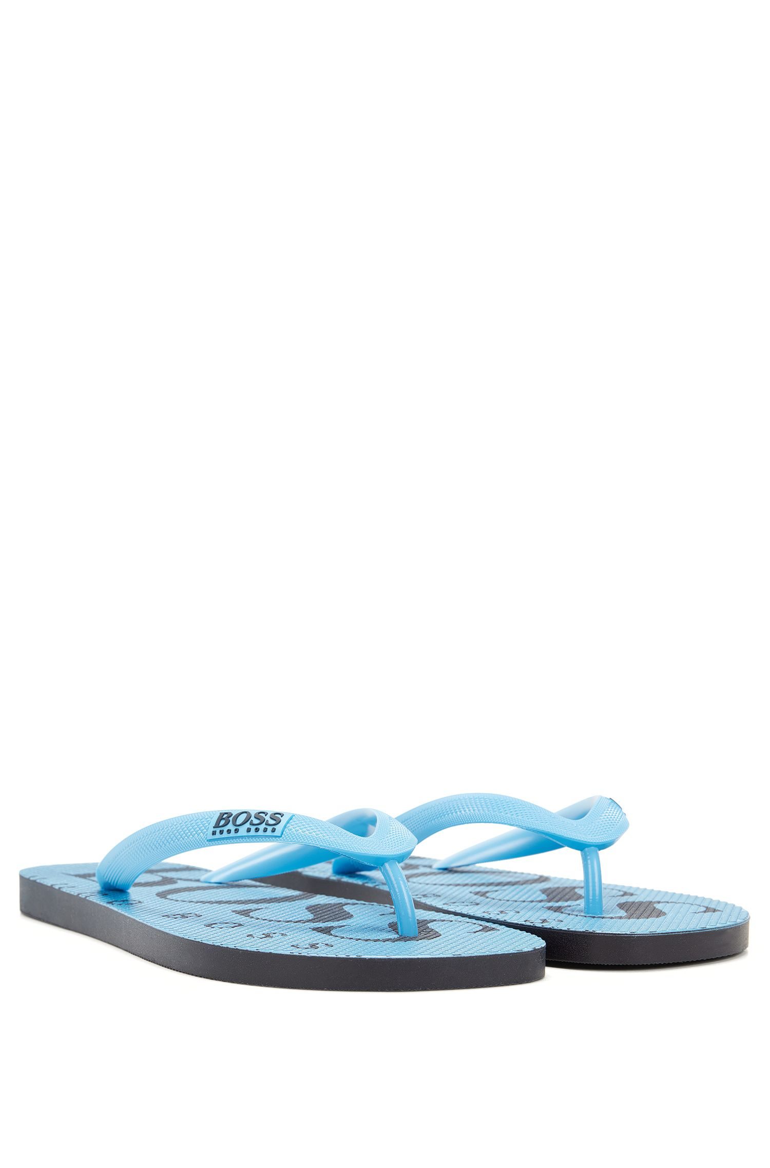 Rubber flip-flops with contrasting logo detail
