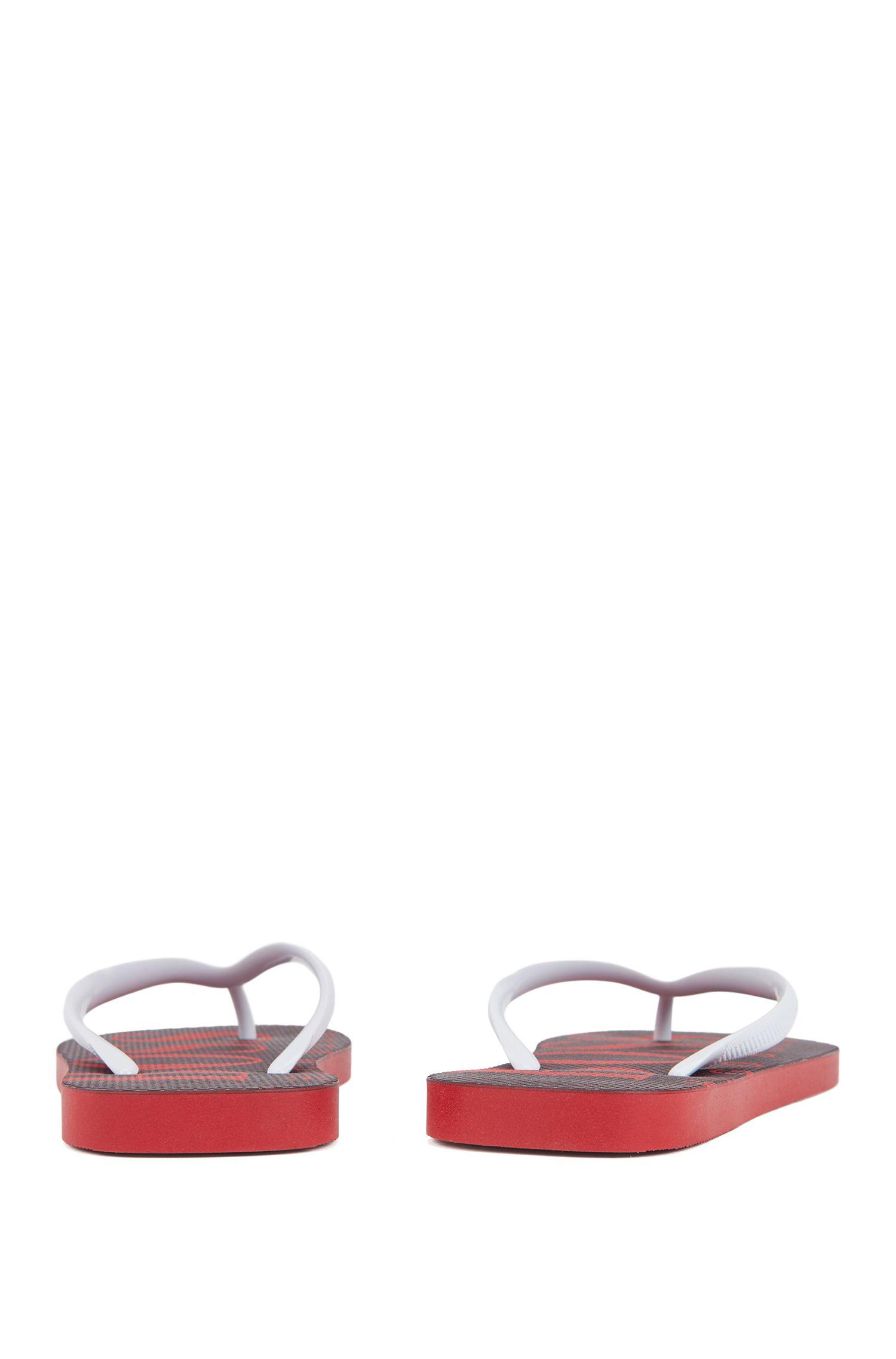 Flipflops aus Gummi mit kontrastfarbenem Logo, Rot