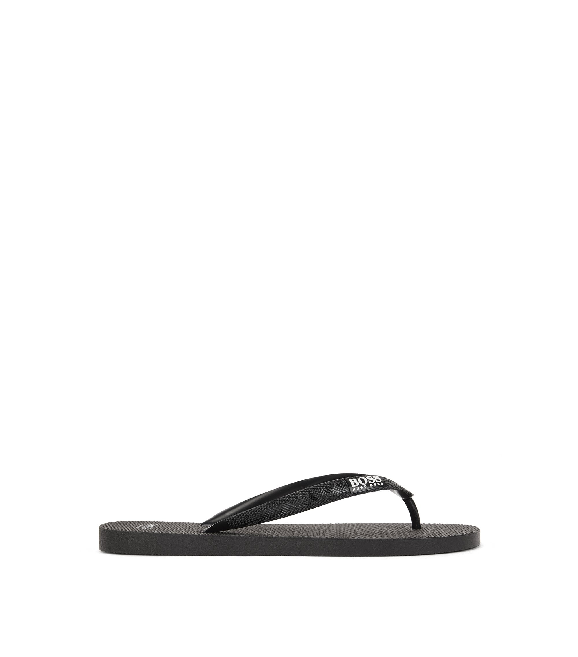 Toe-post flip-flops in textured rubber, Black