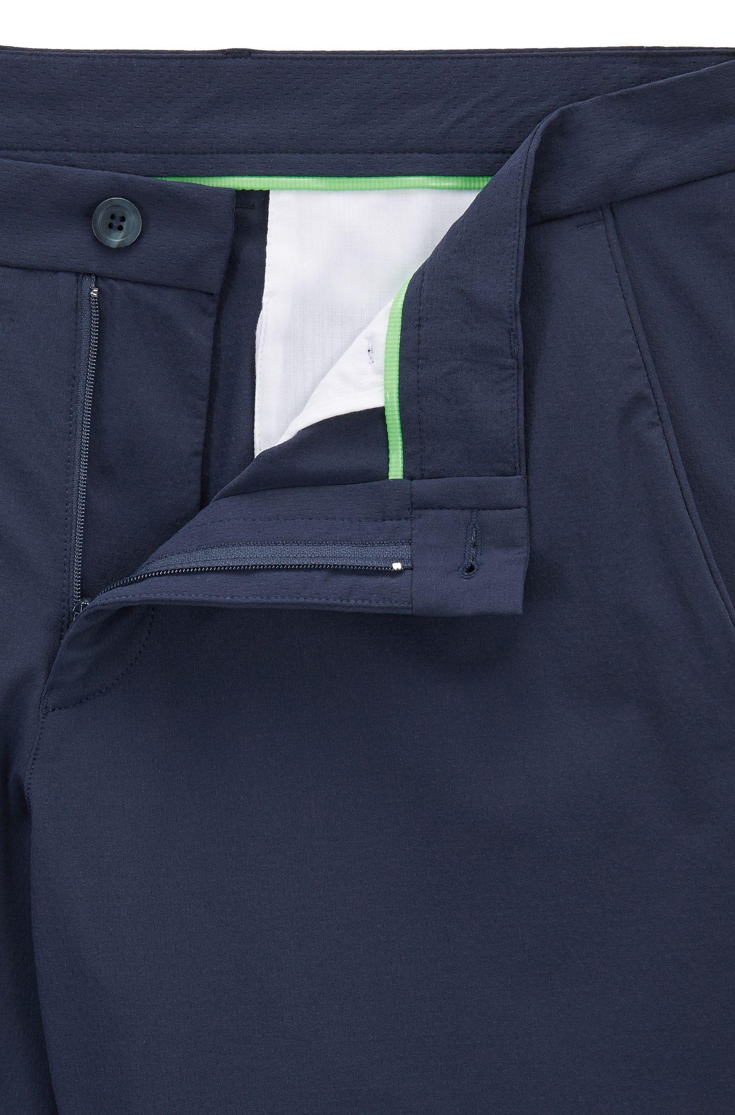 Extra slim-fit waterafstotende broek van dobby met stretch, Donkerblauw