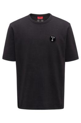 Camiseta oversized fit en algodón elástico con detalle de insignia, Negro
