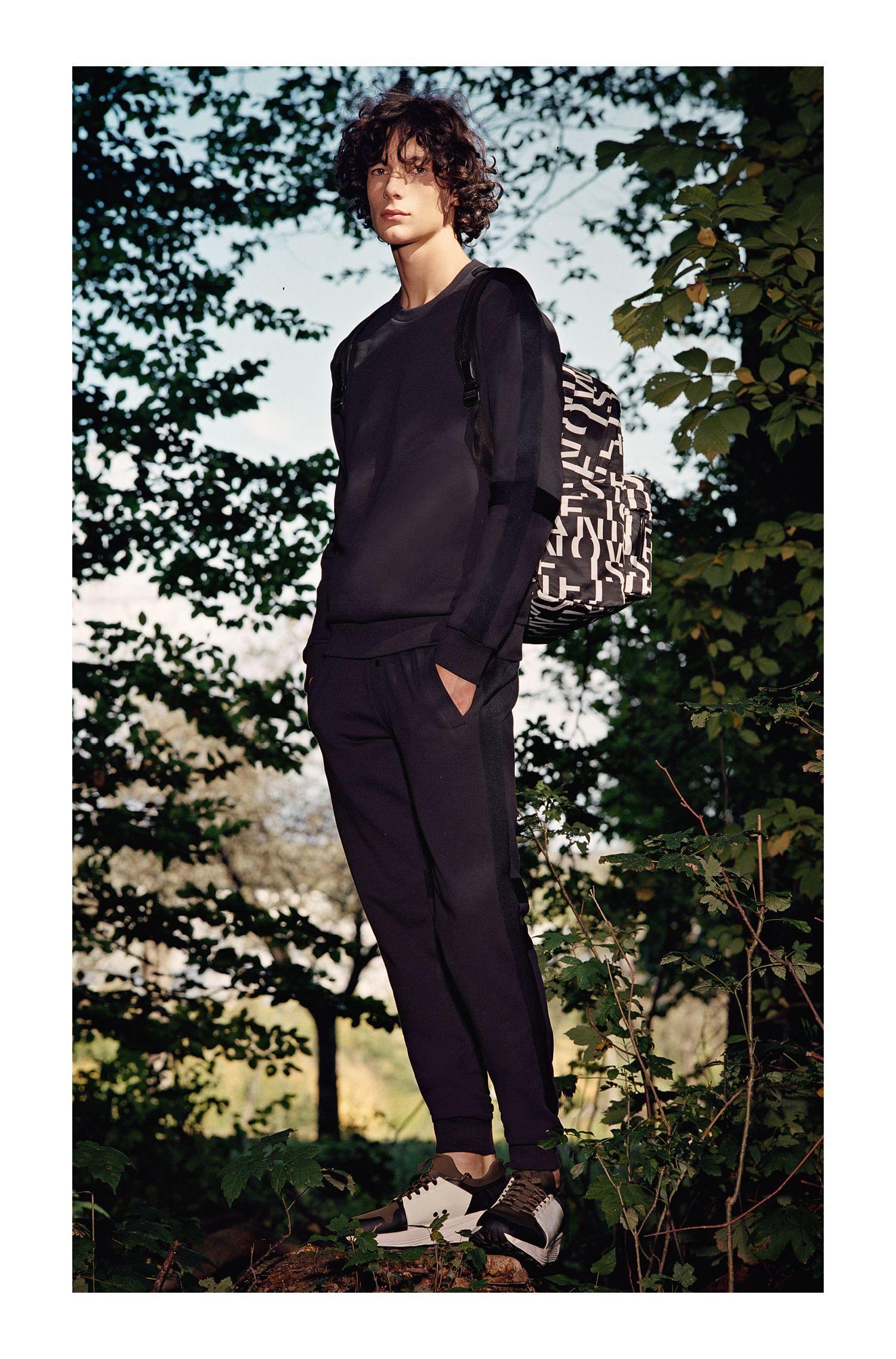 Pantalon de jogging en coton à rayures latérales