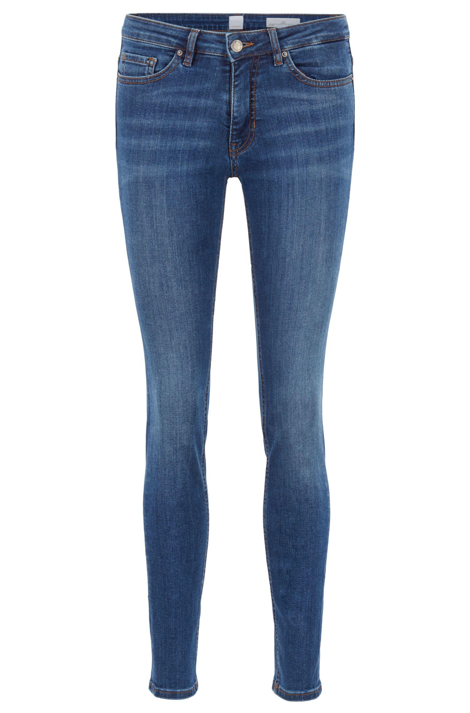 Jeans slim fit in denim super-elasticizzato effetto usato, Blu scuro