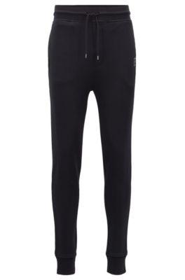 Jogginghose aus French Terry mit Bündchen und Web-Logo, Schwarz