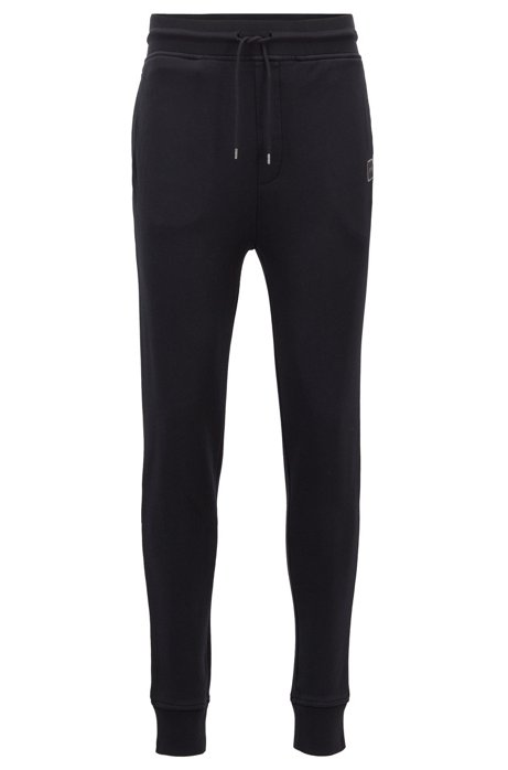 10718ea92 BOSS - Cuffed jogging bottoms in French terry with woven logo
