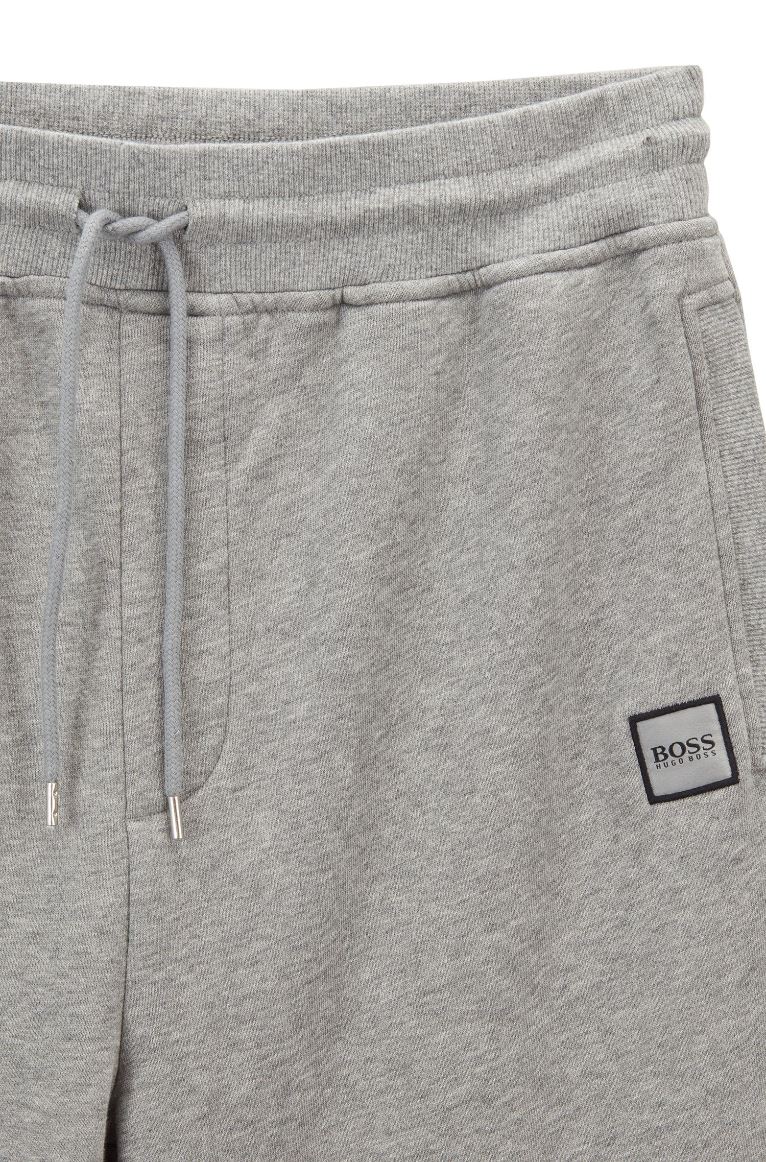 Cuffed jogging bottoms in French terry with woven logo, Light Grey