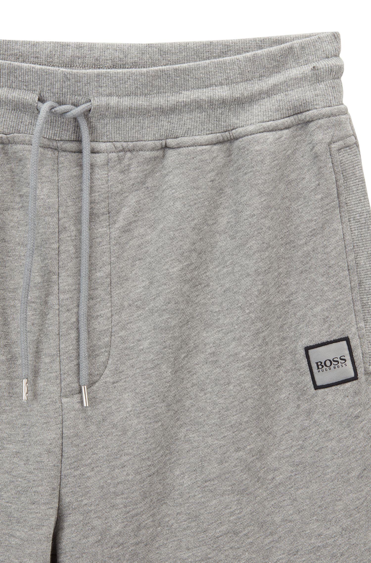 Pantalones de chándal con puños en felpa de rizo con logo tejido, Gris claro