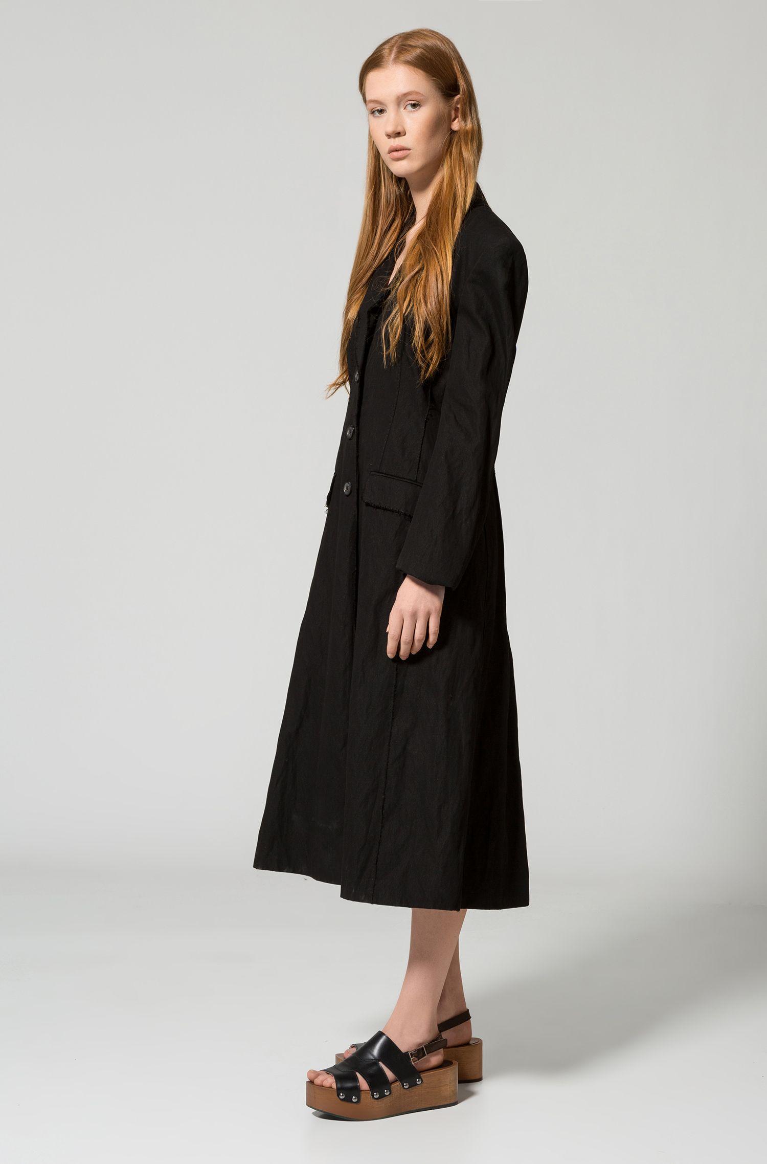 Manteau oversize long à bords francs