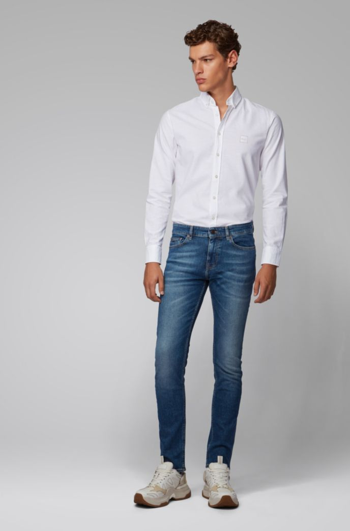 Slim-fit jeans in mid-blue distressed stretch denim