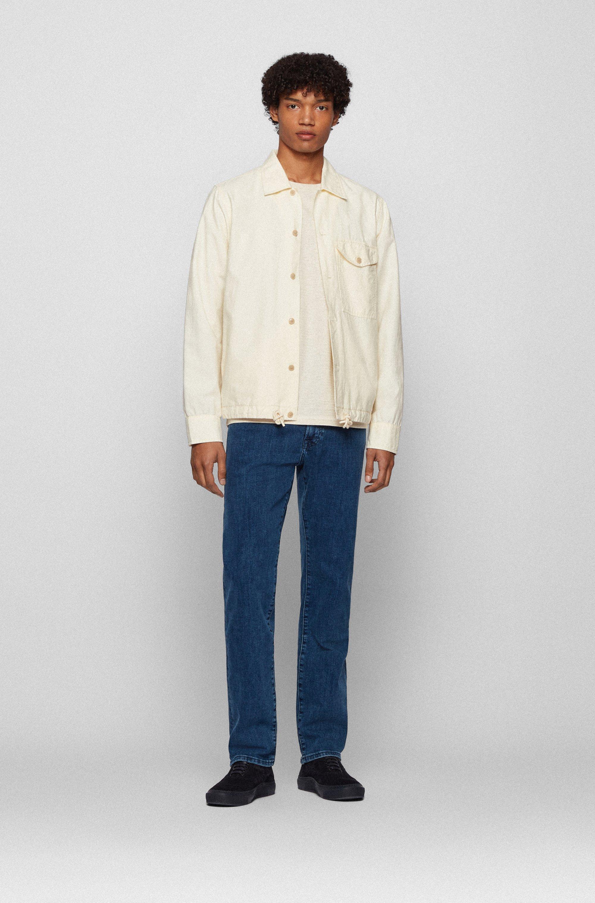 Jeans regular fit in denim elasticizzato blu medio con effetto vintage