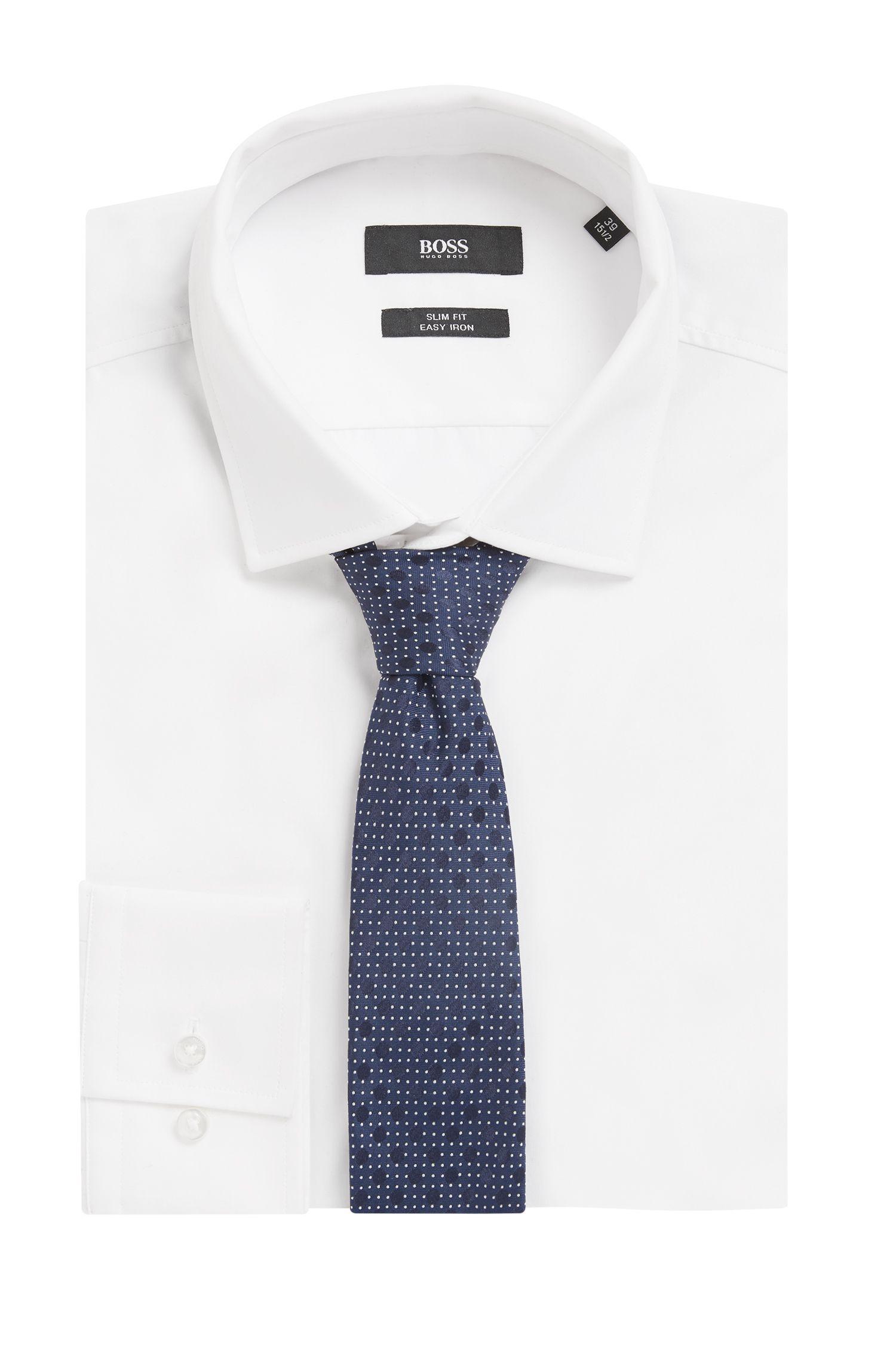 Cravate à motif en jacquard de soie confectionnée en Italie, Bleu