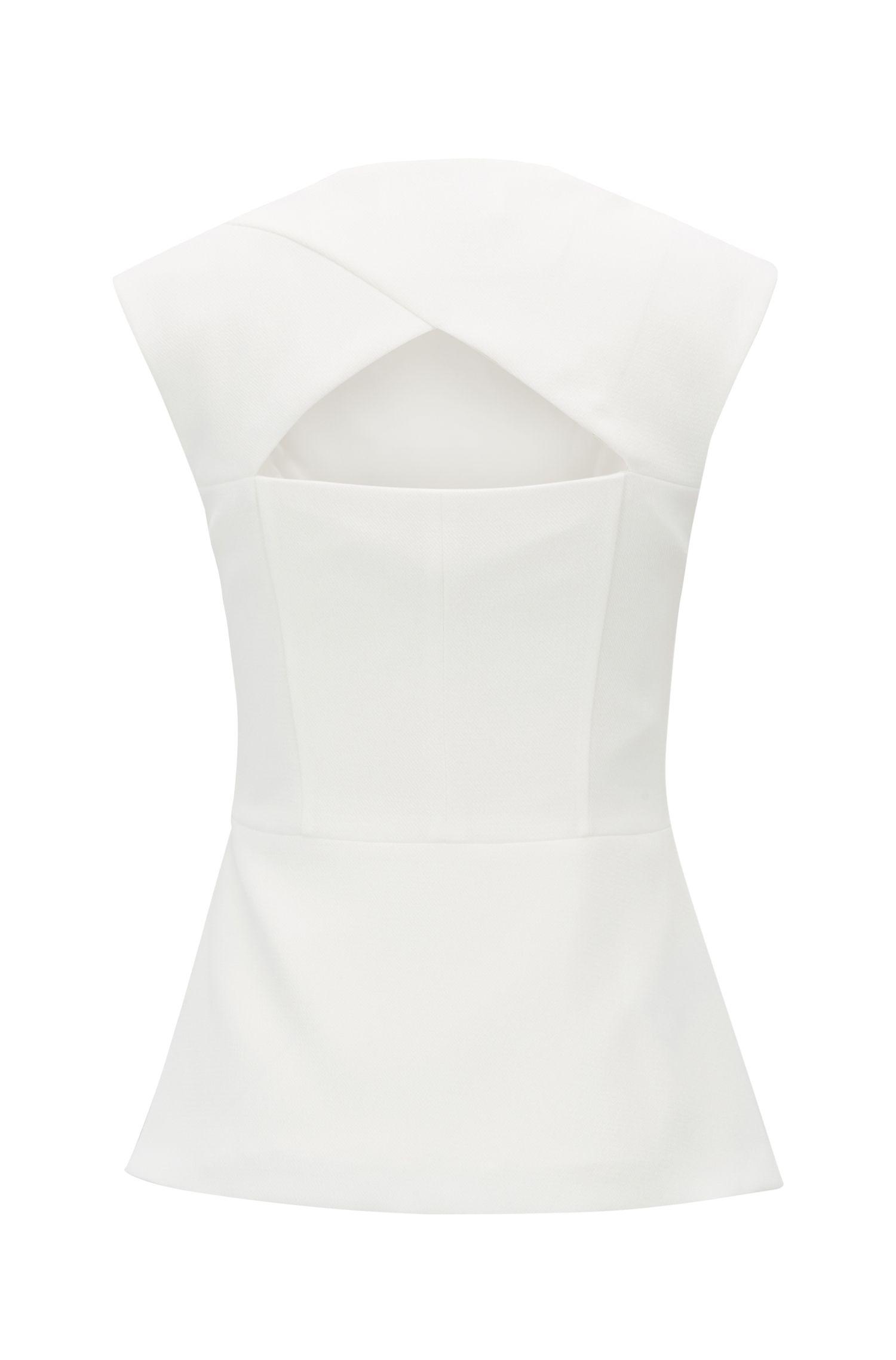 Blusa slim fit in crêpe lavorato e dettagli cutout