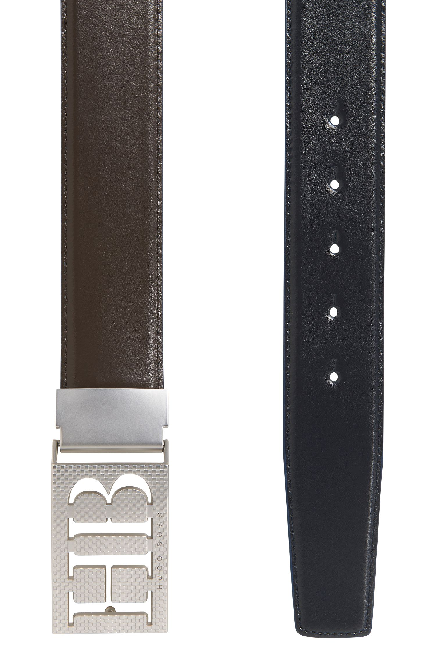 Reversible leather belt with statement plaque closure
