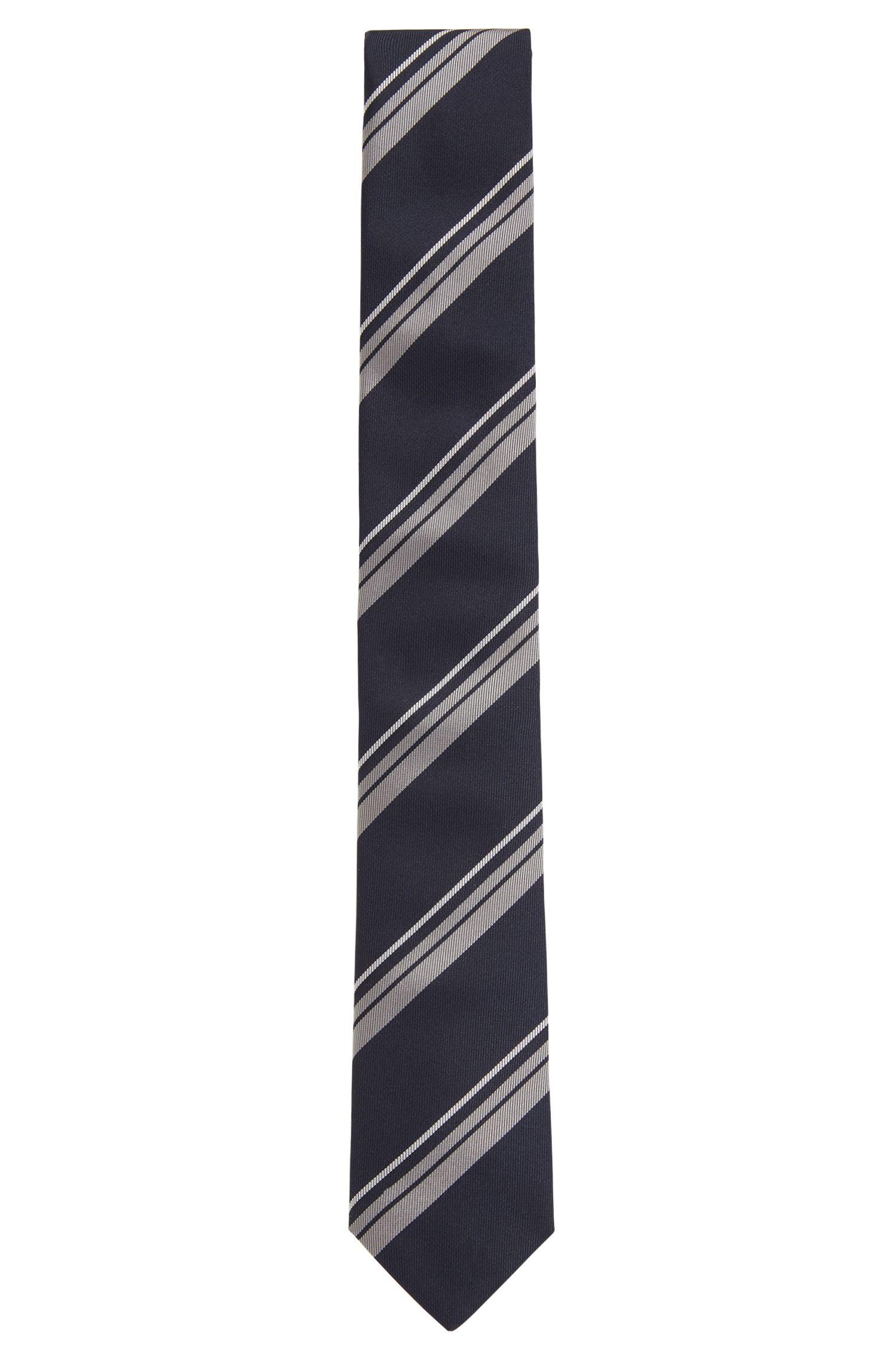 Corbata hecha a mano con rayas diagonales en jacquard de seda, Azul