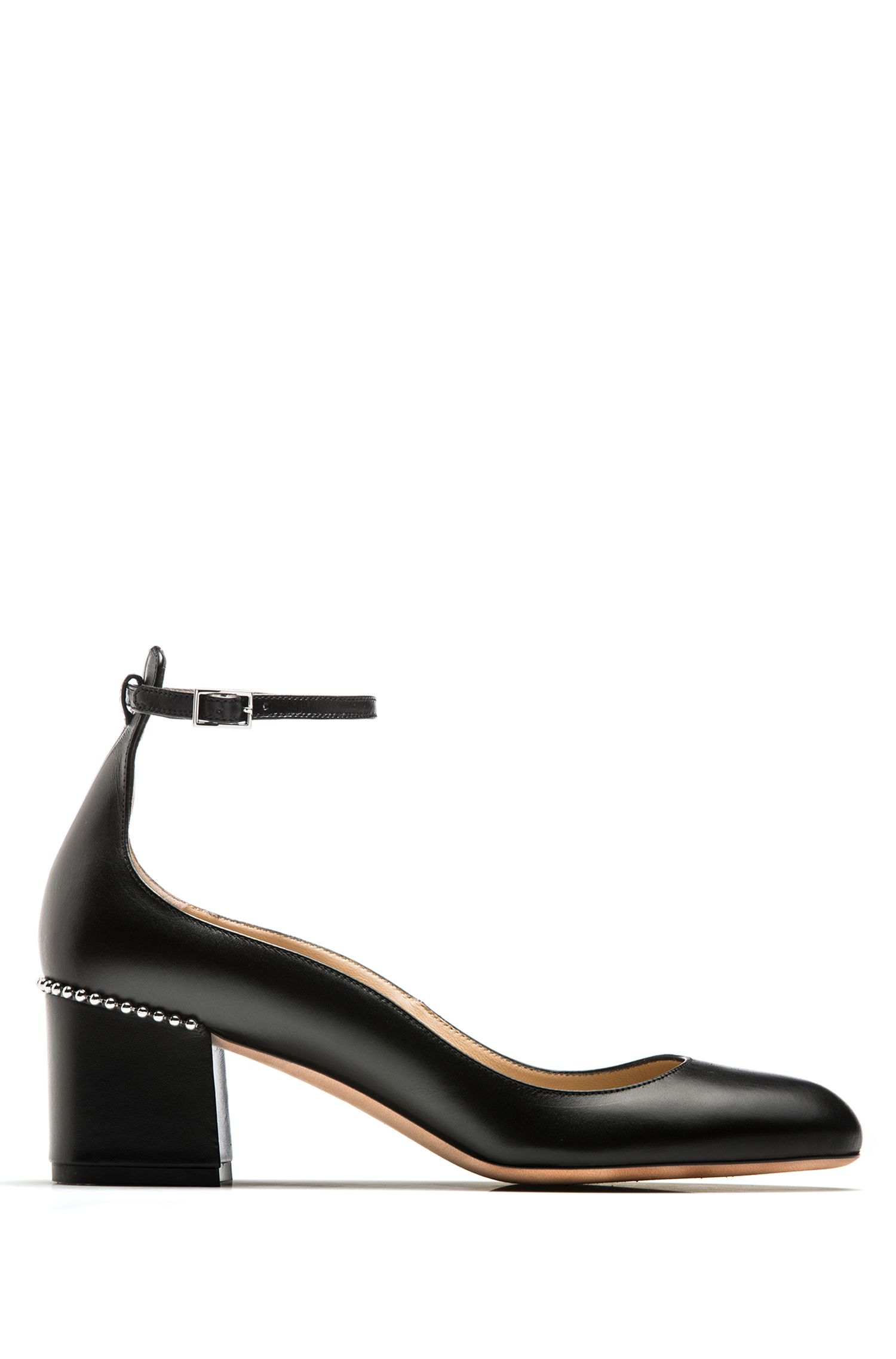 Calf-leather pumps with ankle strap and studs