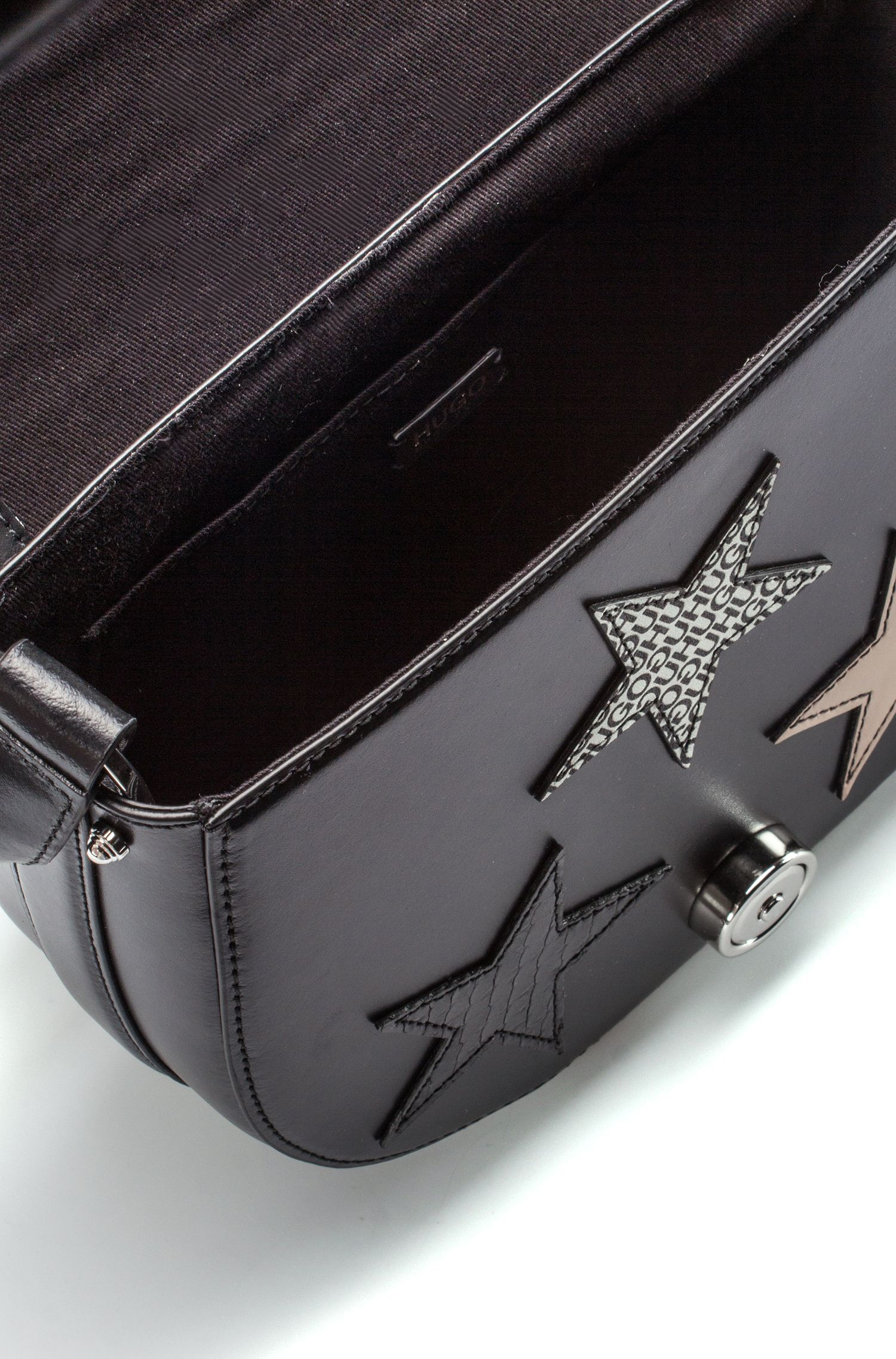Cross-body bag in coated leather with star motifs, Black