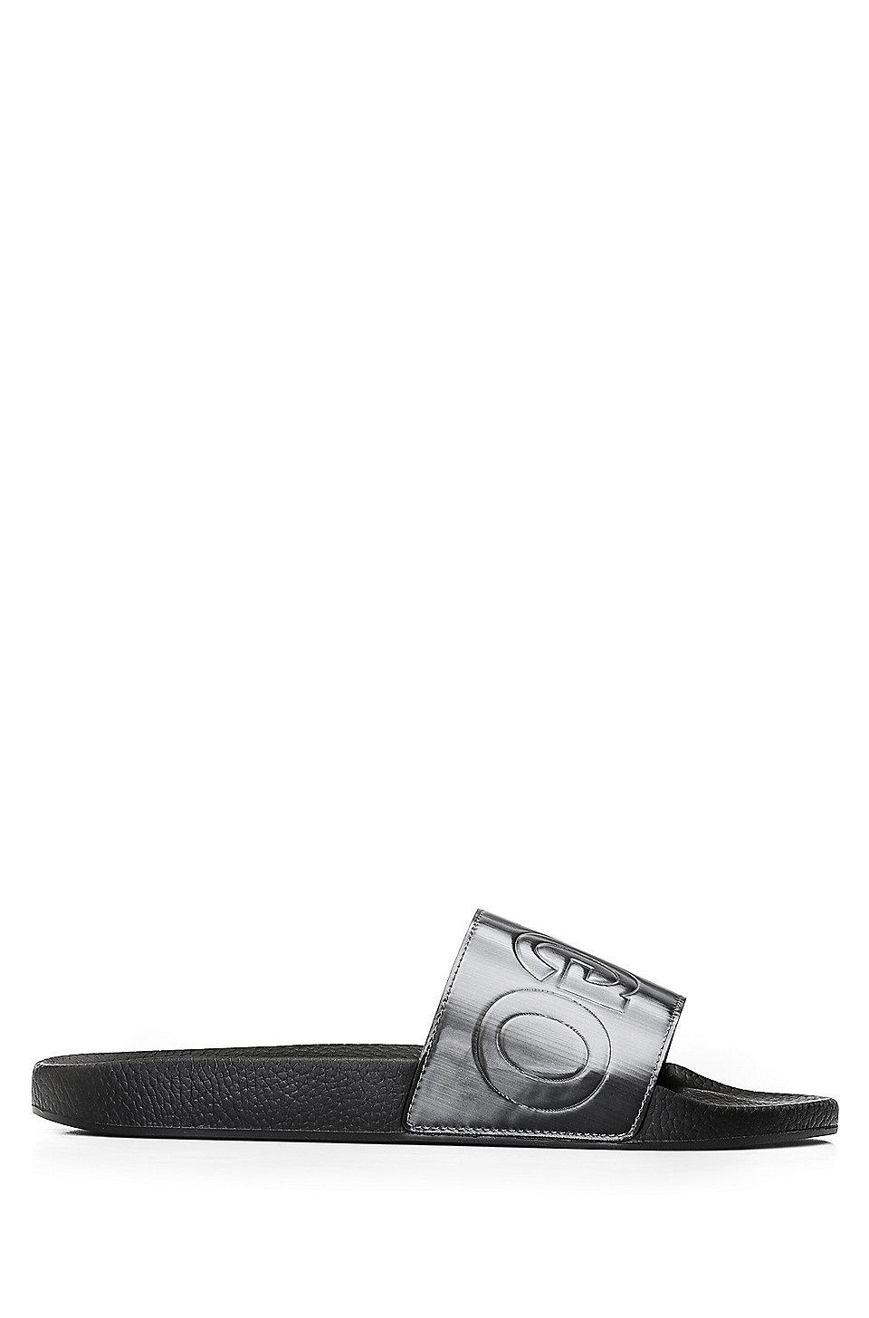 4f341f87b75c HUGO - Italian-made slider sandals with reverse logo