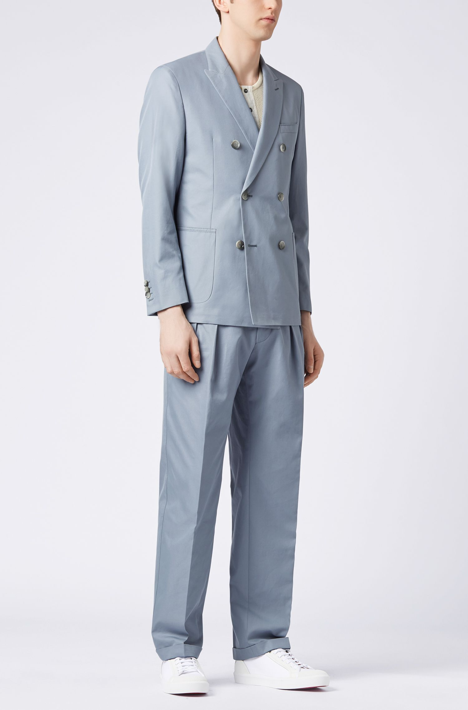 Relaxed-fit high-waisted pleated trousers in Italian cotton