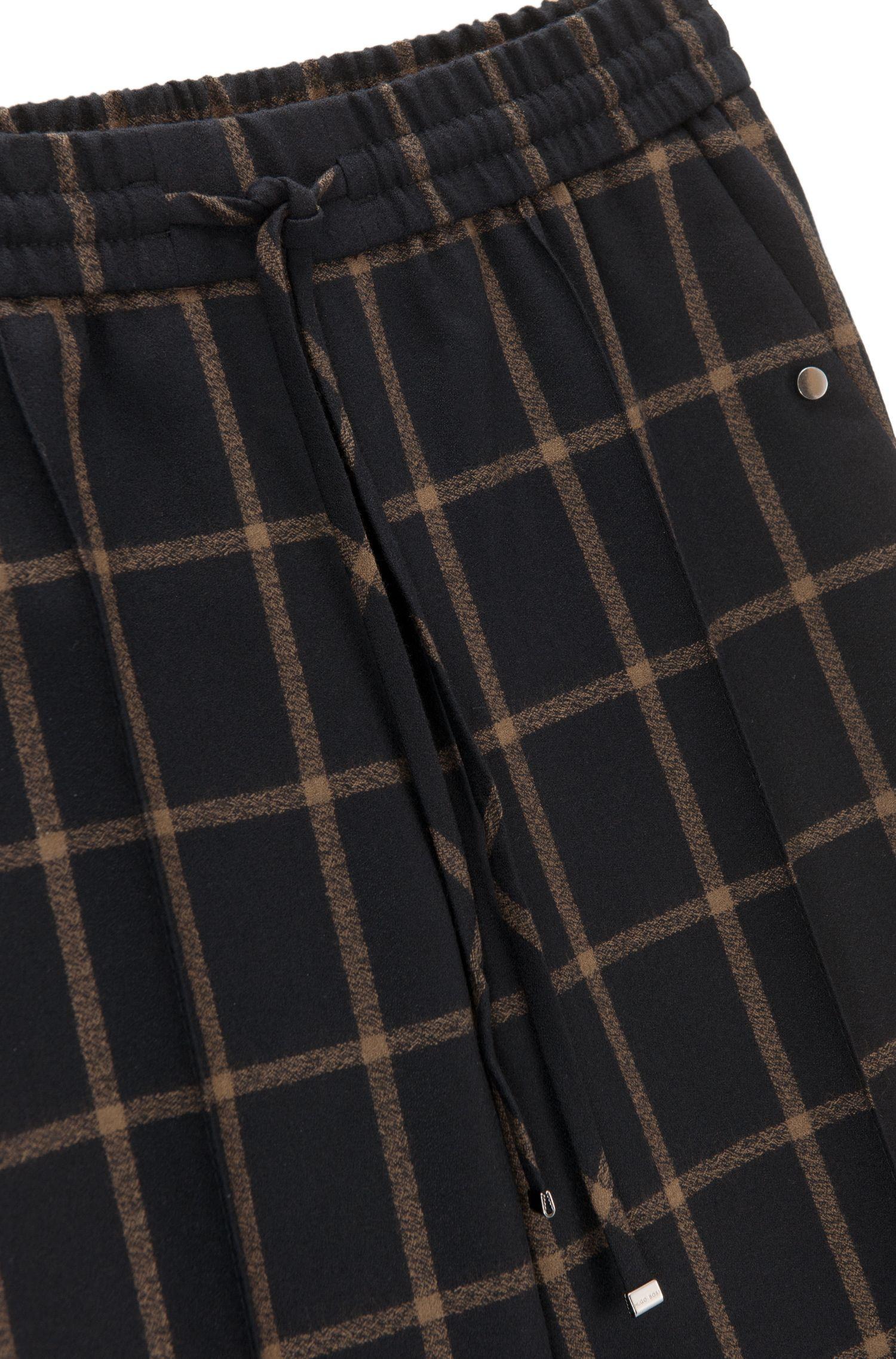 Relaxed-fit, iets kortere broek met trekkoord, van geruite scheerwol