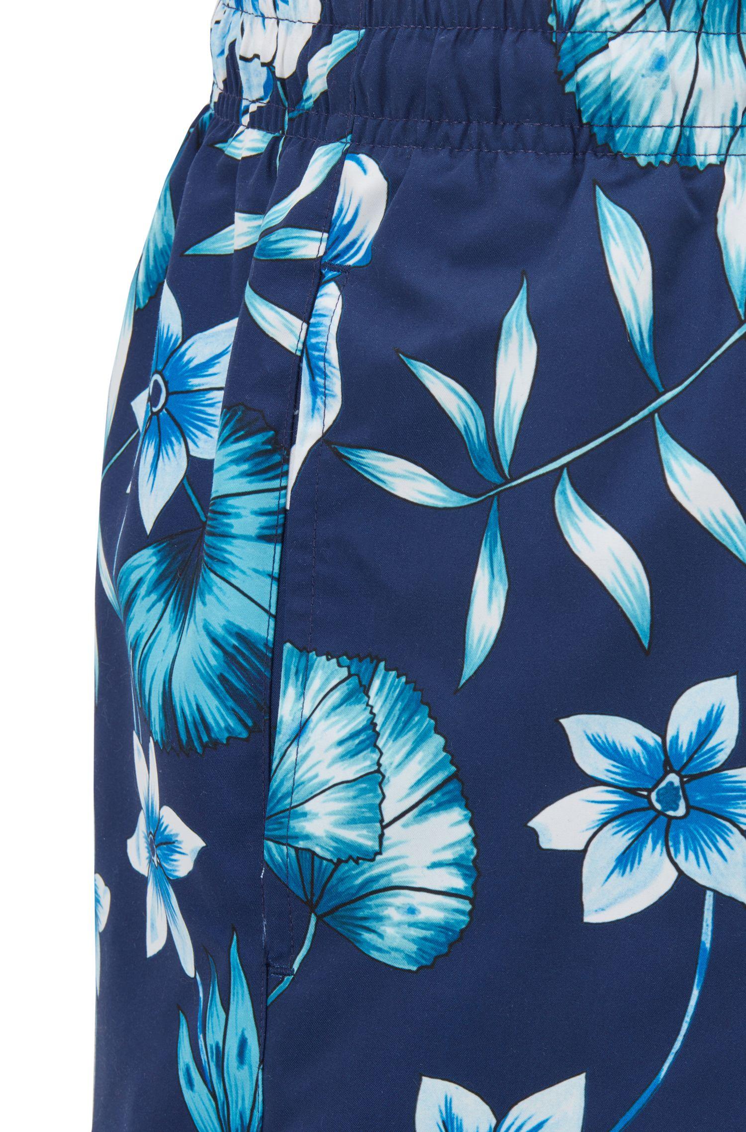 Bañador tipo shorts en tejido técnico con función de secado rápido y estampado floral, Celeste