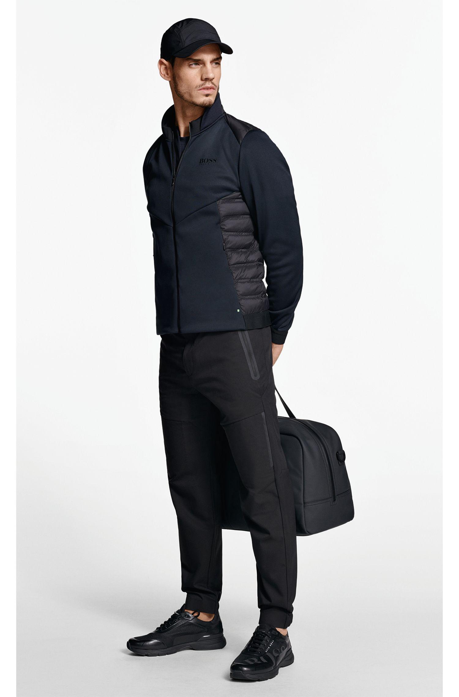 Pantalones con puños en sarga elástica extensible repelente al agua, Negro