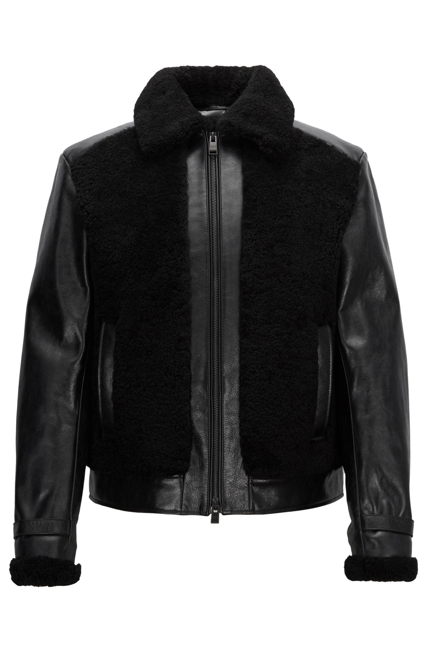 Veste en cuir d'agneau nappa avec empiècements en peau lainée et tissu matelassé, Noir