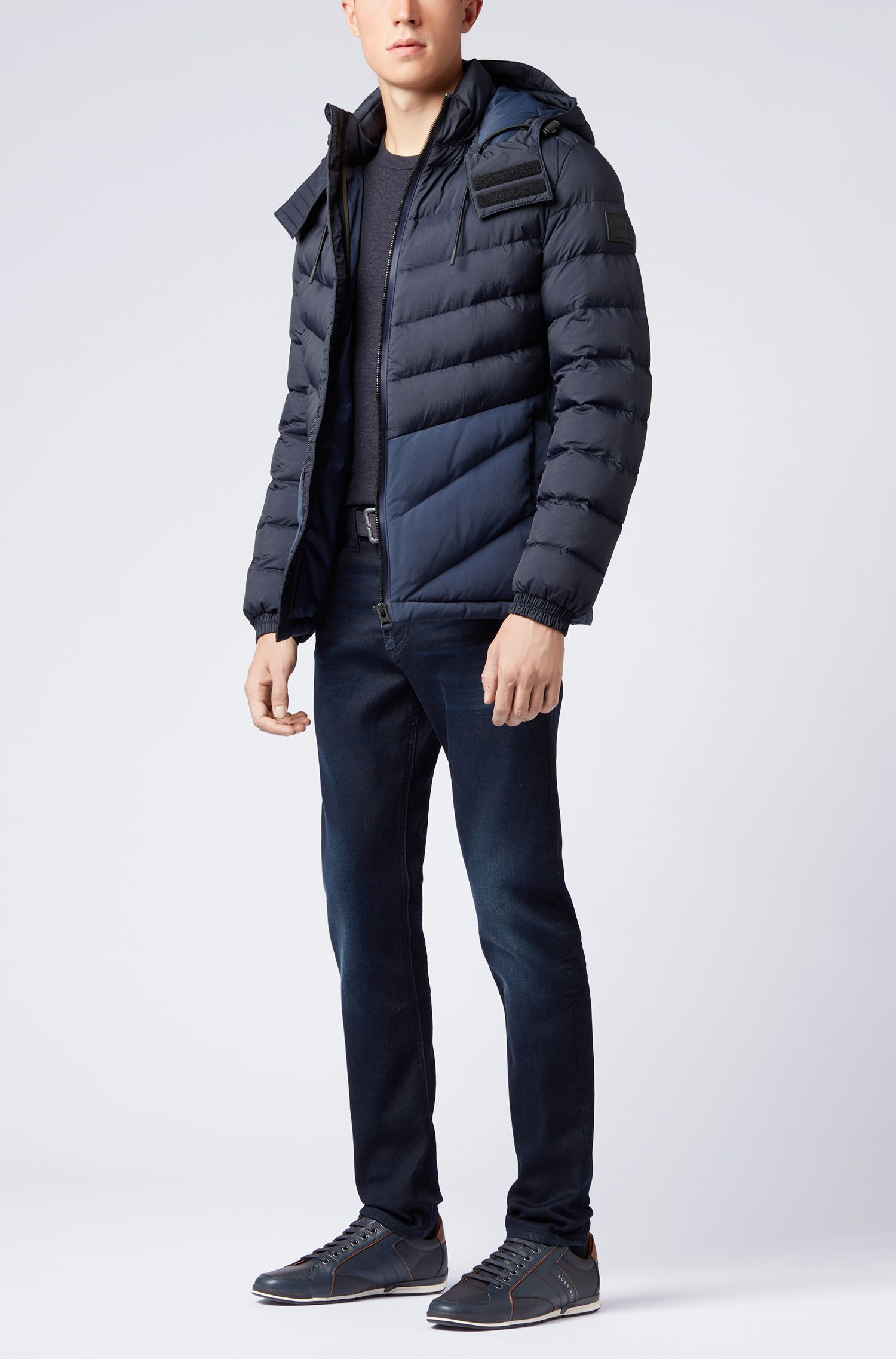 Padded jacket in water-repellent fabric with detachable hood