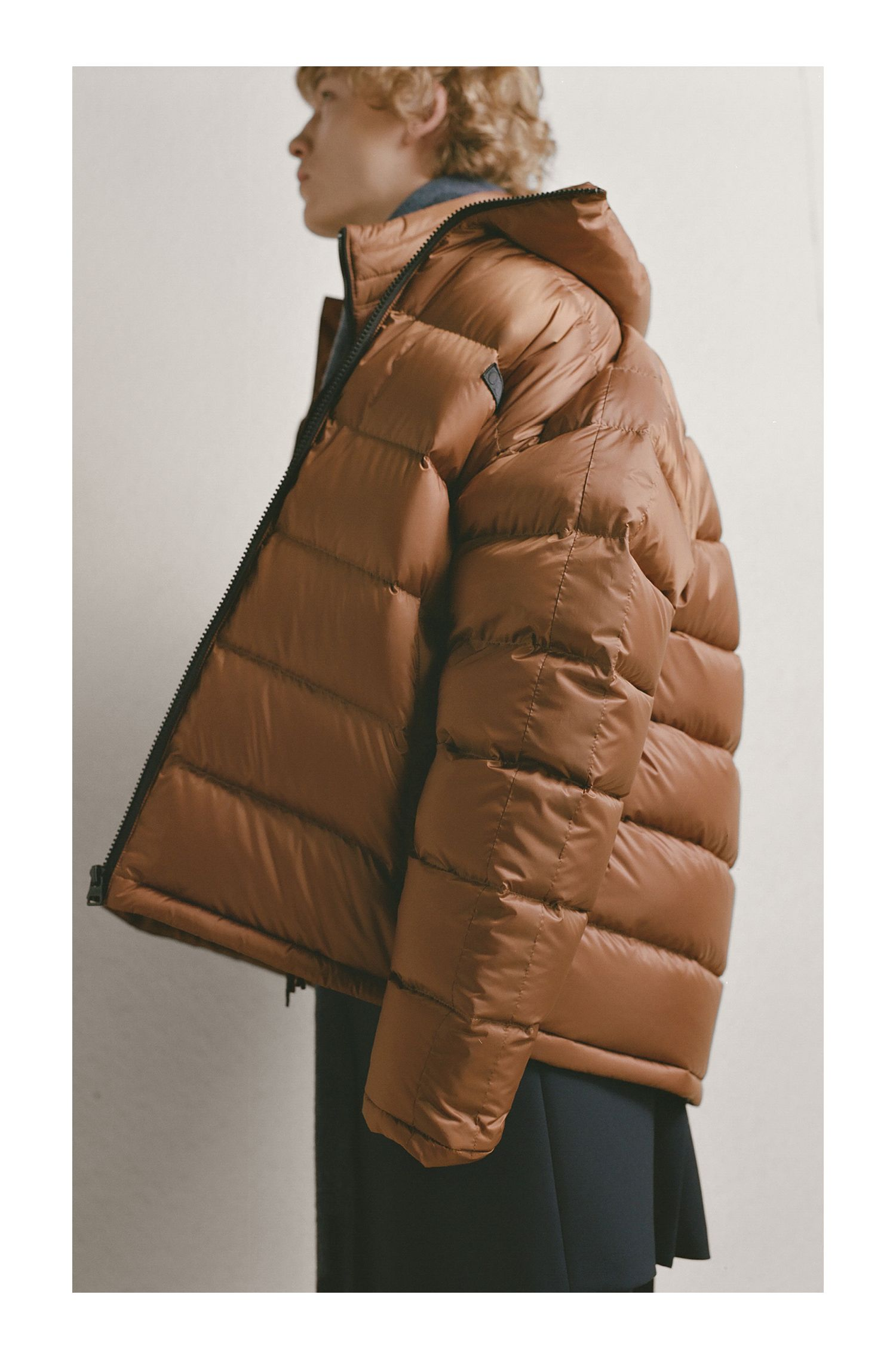 Down-filled gilet in water-repellent fabric with hood