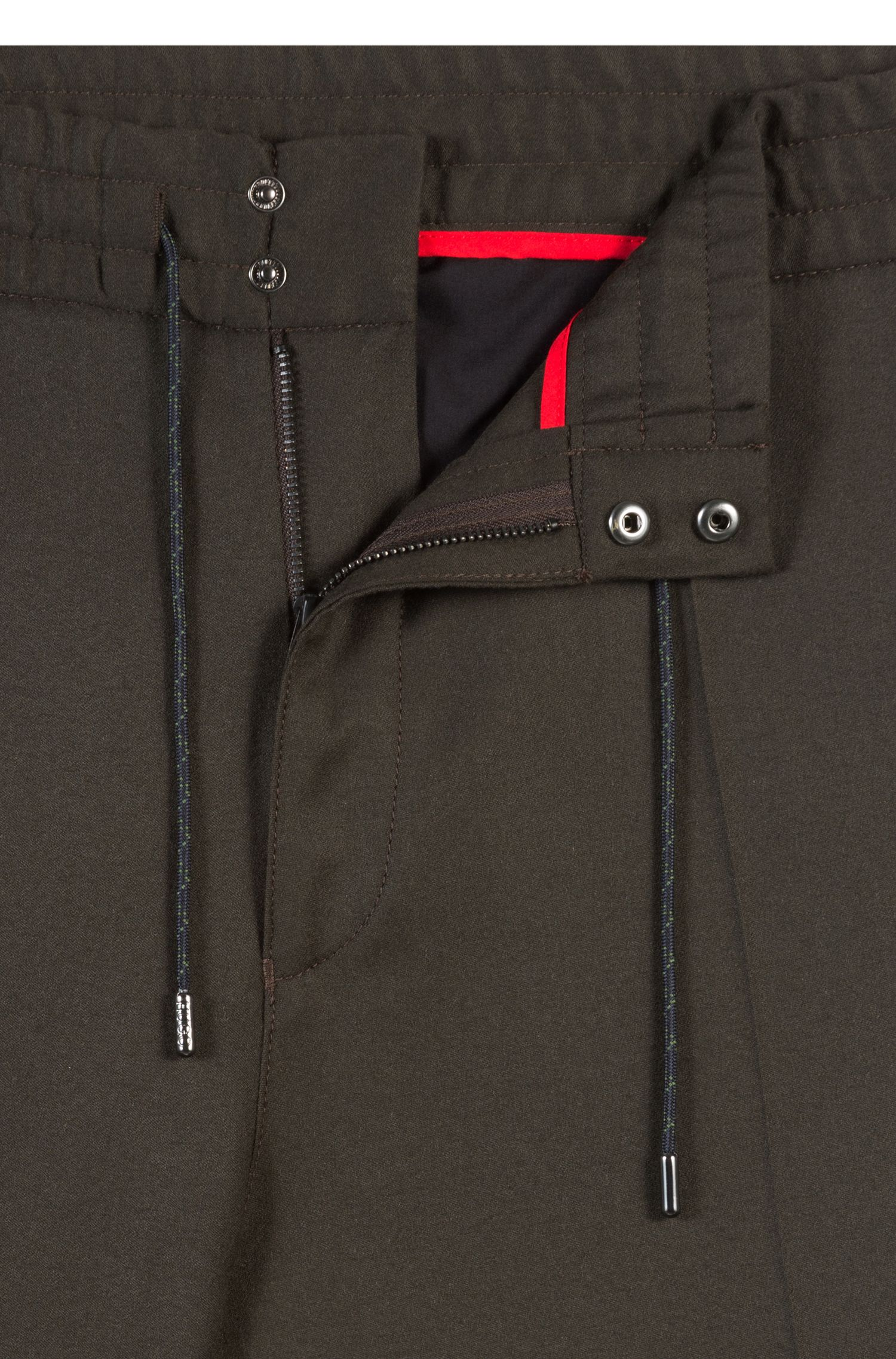 Tapered-fit broek met elastische taille, van scheerwol met stretch
