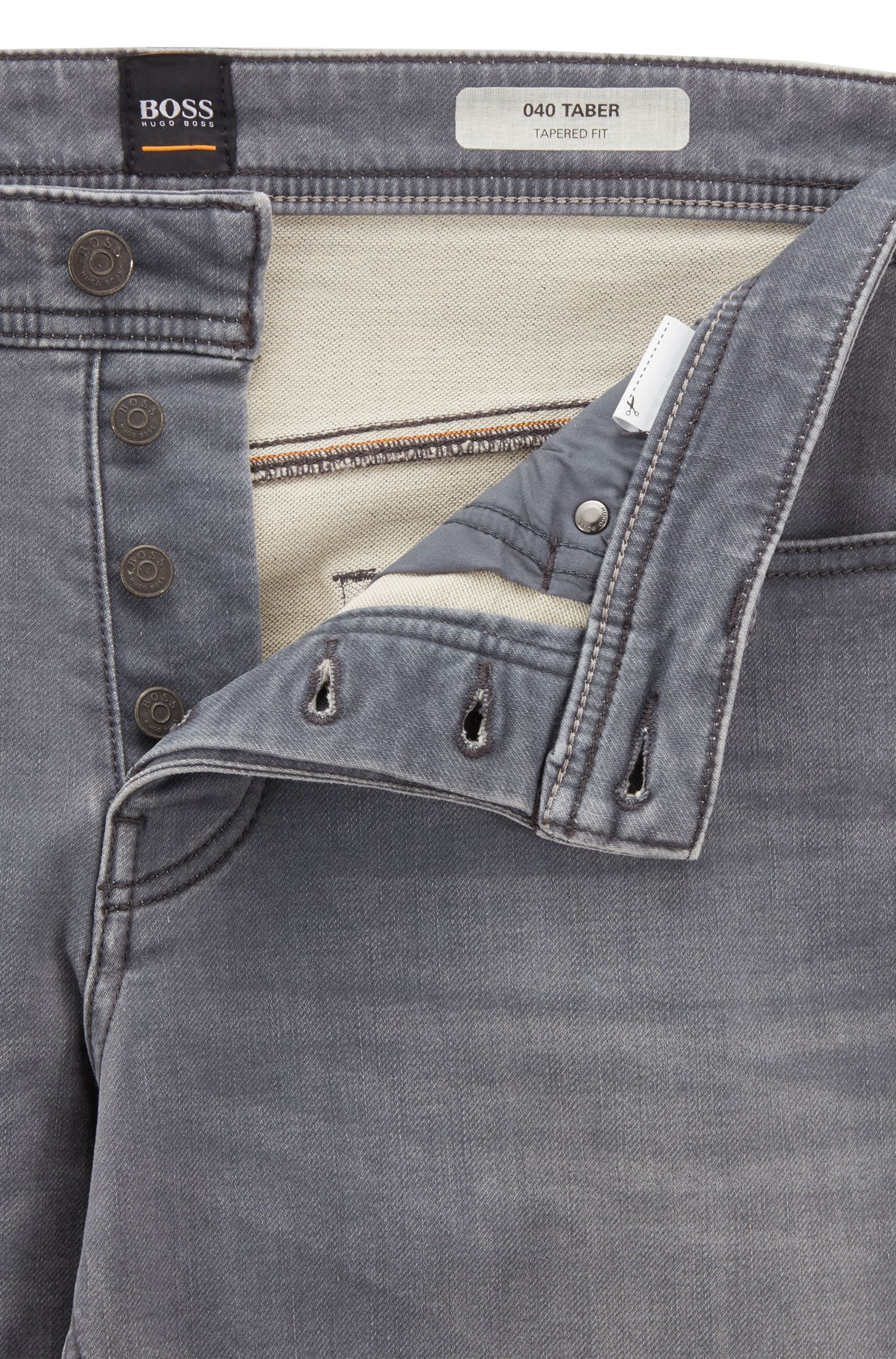 Vaqueros tapered fit en denim elástico de punto gris, Gris