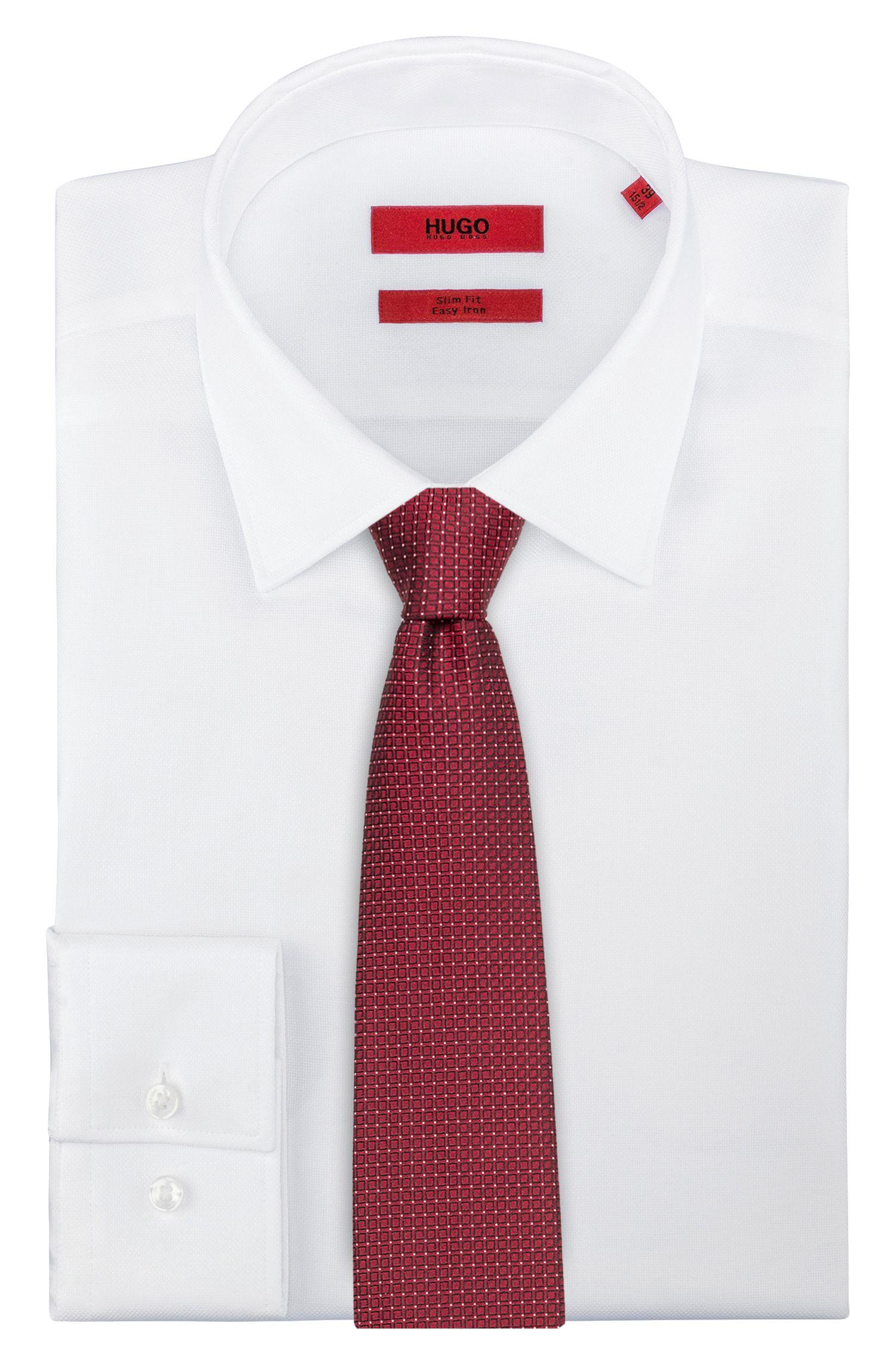 Cravatta jacquard in pura seta con microdisegni