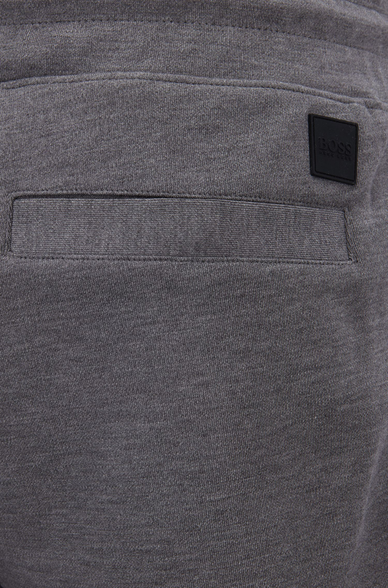 Pantalon imperméable resserré en bas des jambes, avec finitions en tissu technique, Gris