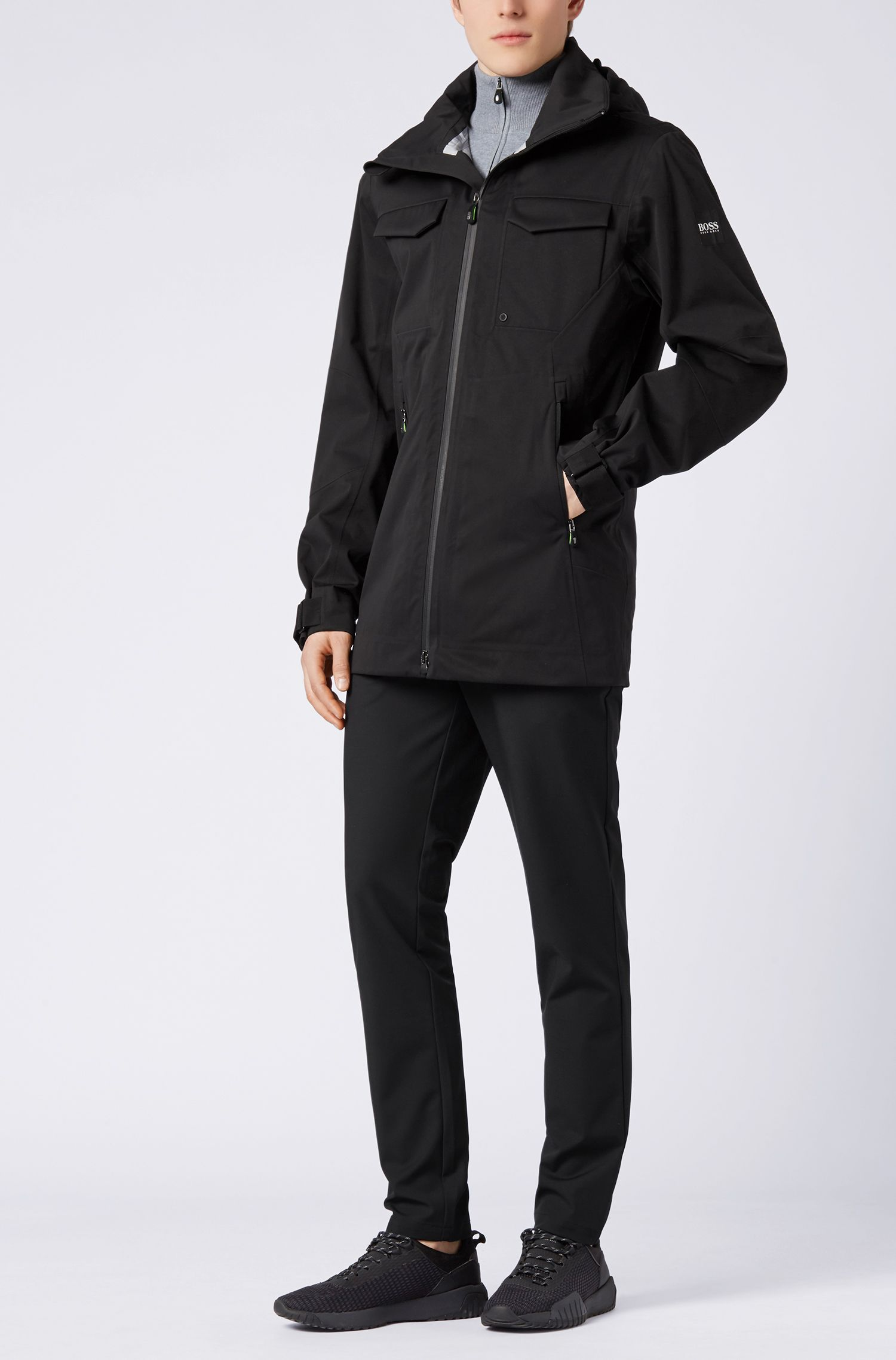 Veste imperméable en softshell à capuche dissimulable, Noir