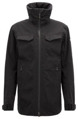 Waterdichte softshell jas met opvouwbare capuchon, Zwart