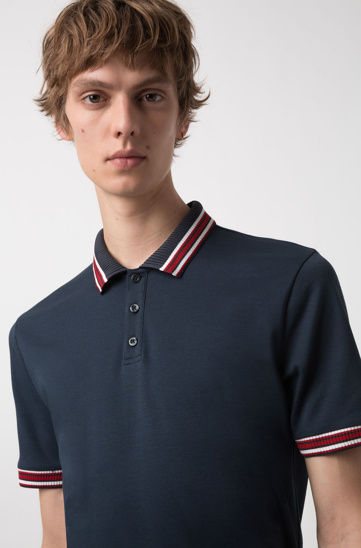 Polo regular fit in cotone con profili a righe, Blu scuro