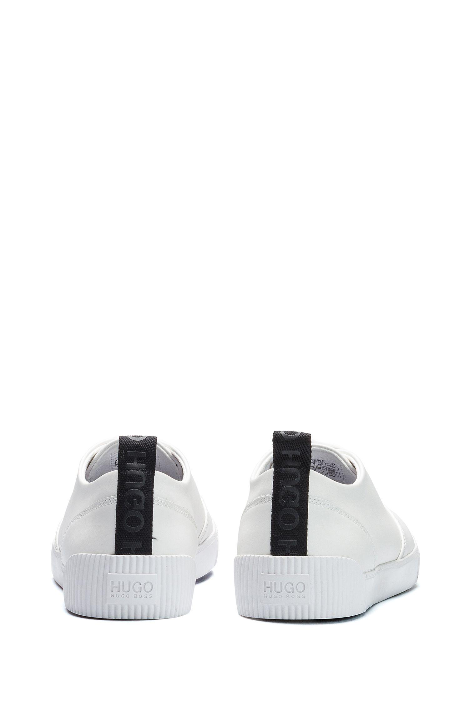 Sneakers in pelle con impunture