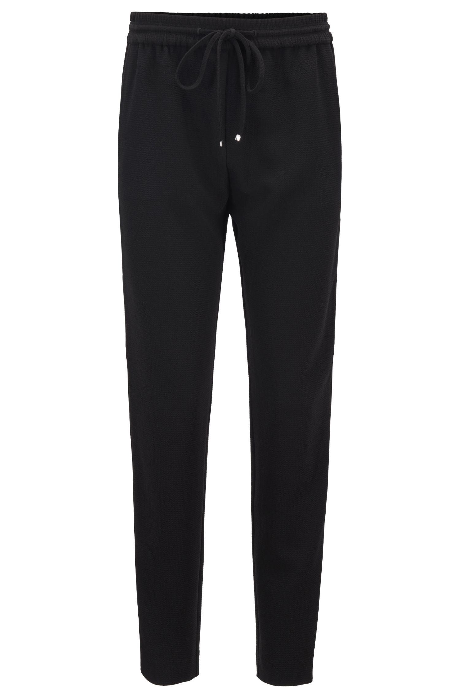 Pantalones regular fit en crepé con cinta en las costuras laterales, Negro