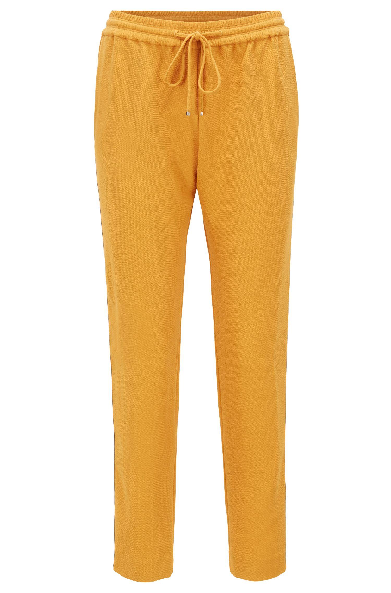 Pantalon en crêpe Regular Fit avec rubans sur les coutures latérales, Or