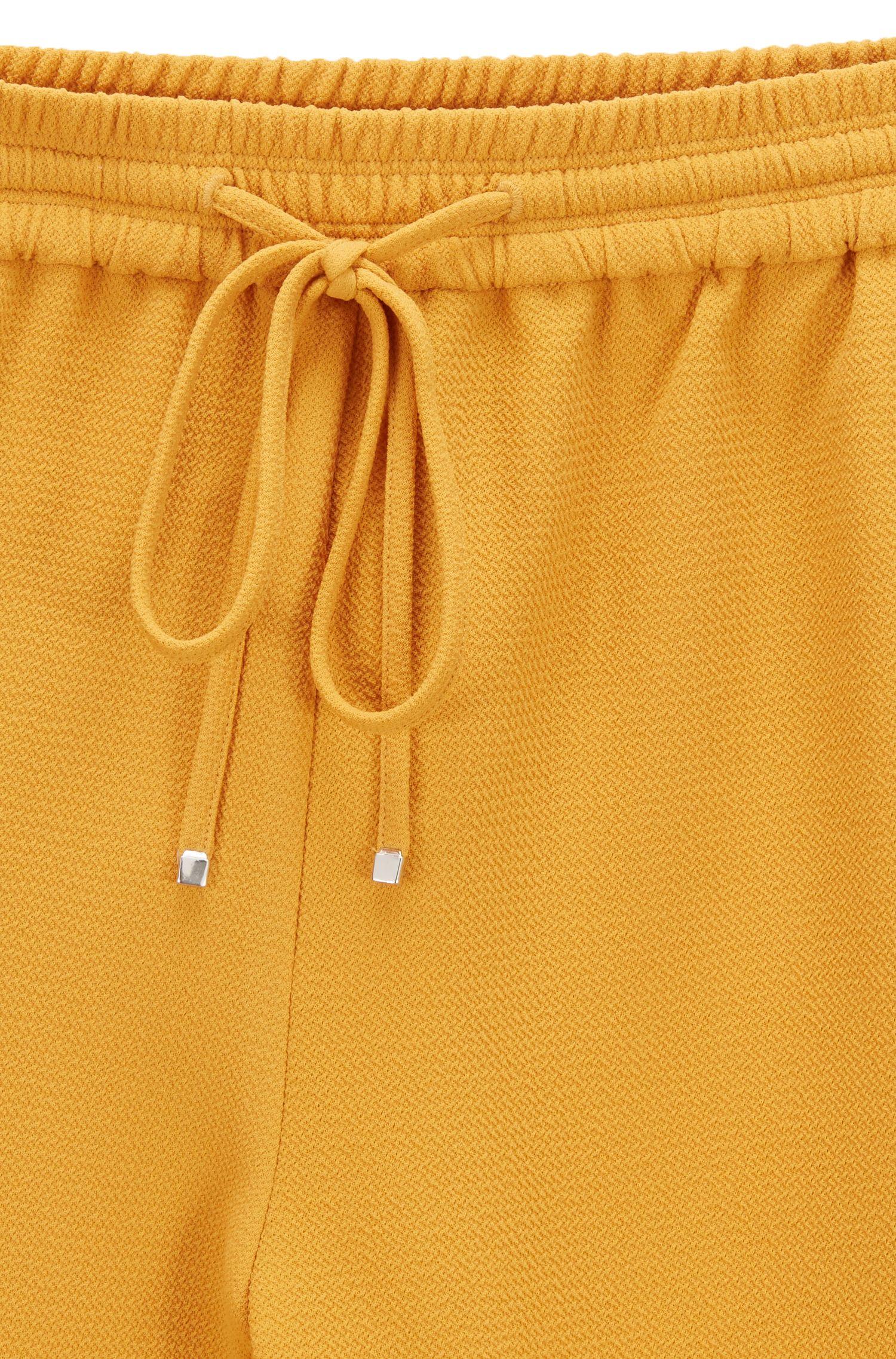 Regular-fit crêpebroek met biezen aan de zijnaden, goud