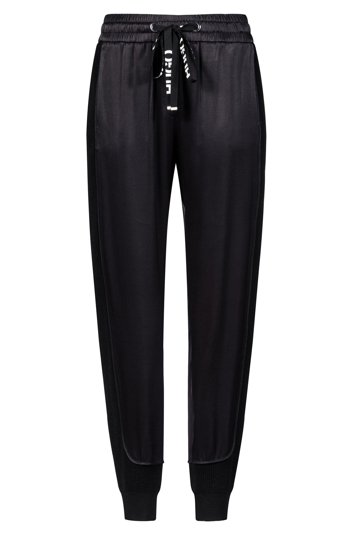 Pantalones relaxed fit en tejido brillante con apliques de punto, Negro