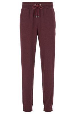 Melierte Loungewear-Hose aus zweiseitigem Baumwoll-Mix mit Bündchen, Dunkelrot