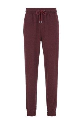 Pantalones homewear en tejido jaspeado de doble cara con puños, Rojo oscuro